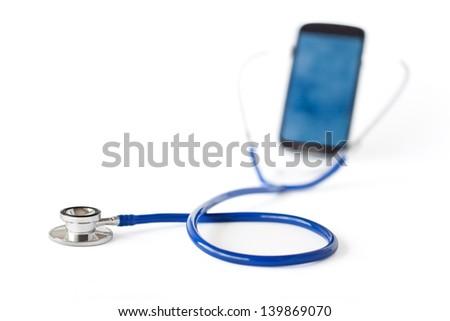 Stethoscope and mobile phone isolated on white background - stock photo
