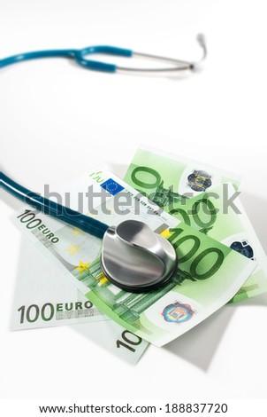 Stethoscope and money bills - stock photo