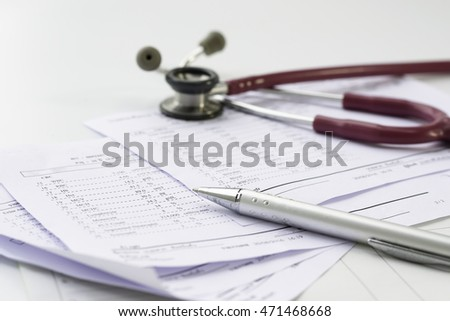 Stethoscope and  pen put on a white background.