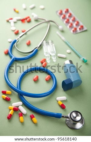 stethoscope and pills - stock photo