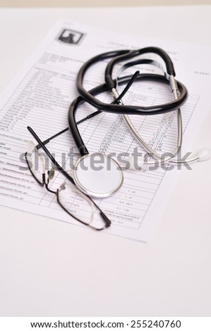 stethoscope and prescription, close up - stock photo