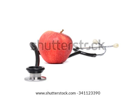 stethoscope and red apple isolated on white background - stock photo