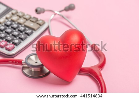 Stethoscope and red heart on pink background - stock photo