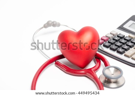 Stethoscope and red heart with calculator on white background , Focus on number at Calculator - stock photo