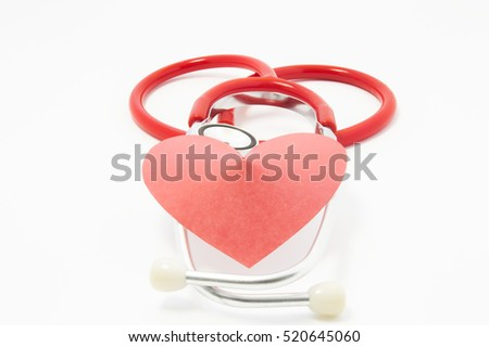 Stethoscope and red velvet heart lie on each other on white uniform background. Photo for use in cardiology, heart health, heart diagnostic equipment, diagnosis and treatment of cardiac disease