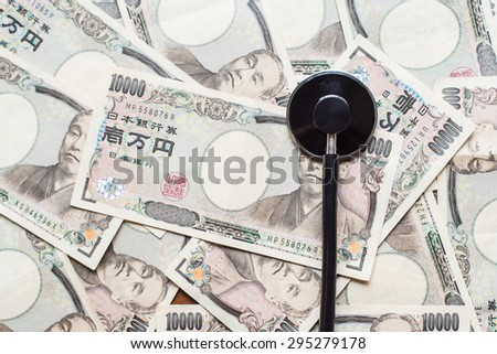 Stethoscope and ten thousands japanese yen