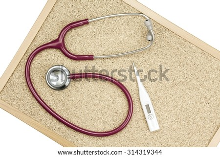 Stethoscope and Thermometer on a cork board, Medical equipment. Examining equipment. (Vintage Style Color) - stock photo
