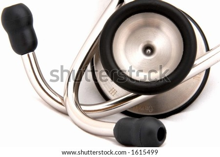 Stethoscope chestpiece and earpieces - stock photo