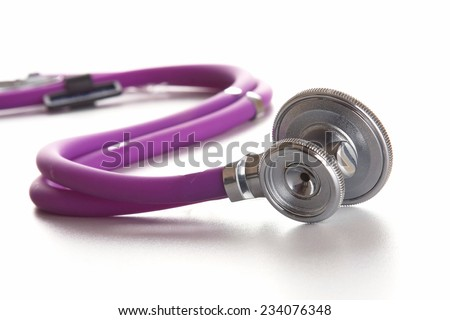 Stethoscope closeup on a white background. Medical Equipment. - stock photo