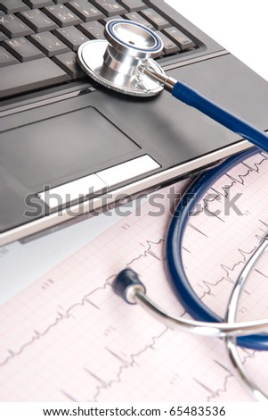 Stethoscope, electrocardiogram (ECG) and laptop - general practitioner doctor workplace - stock photo