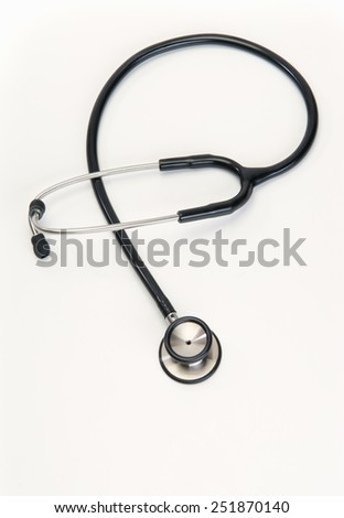 stethoscope for heart health at doctors office - stock photo