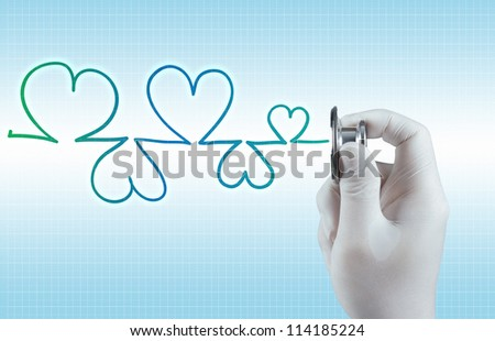 Stethoscope in hand as medical concept - stock photo