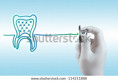 Stethoscope in hand with tooth sign as medical concept - stock photo