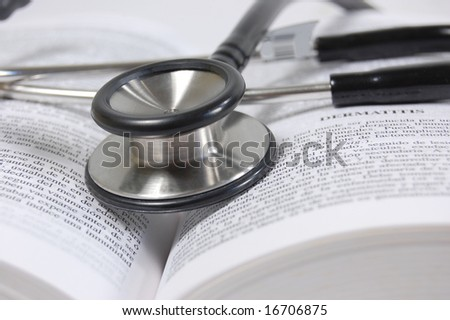 stethoscope in the middle of a text book