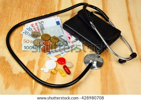 Stethoscope lying on many euro money banknotes - stock photo