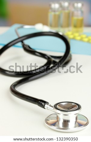Stethoscope lying on the table close up