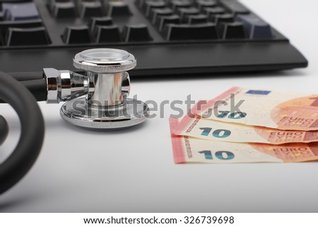 Stethoscope,money, keyboard on white, medical concept.