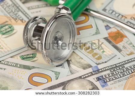stethoscope on a pile of dollars close up