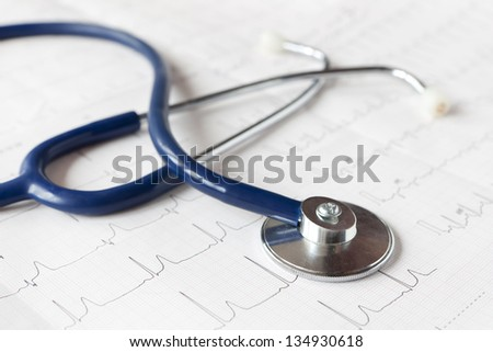 Stethoscope on a printout. - stock photo