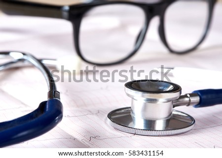 Stethoscope on a white background with cardiogram