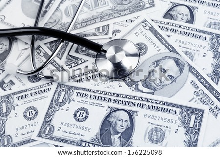 Stethoscope on american banknotes - stock photo