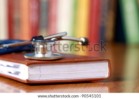 Stethoscope on book with leather cover