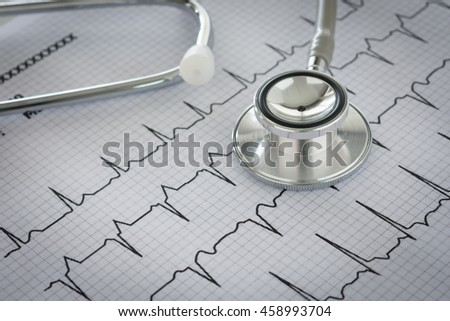 Stethoscope on cardiogram sheet of cardiology patient.   Cardiologist and medical concept - stock photo