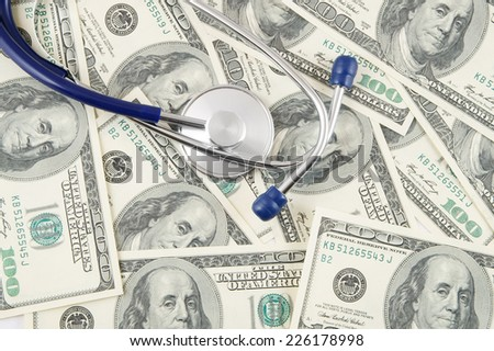 Stethoscope on dollar banknotes, cost of healthcare concept