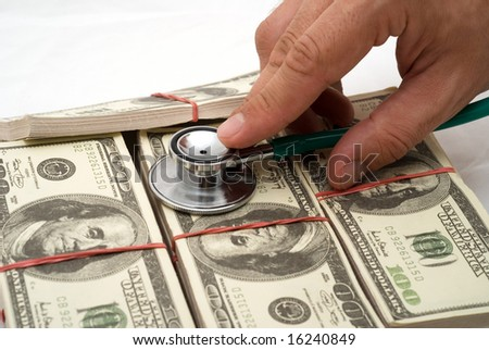 stethoscope on dollars banknotes - stock photo