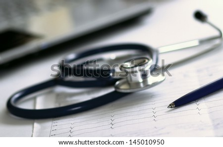 Stethoscope on electrocardiogram