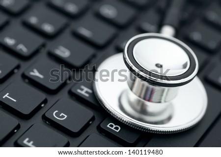 Stethoscope on keyboard - stock photo