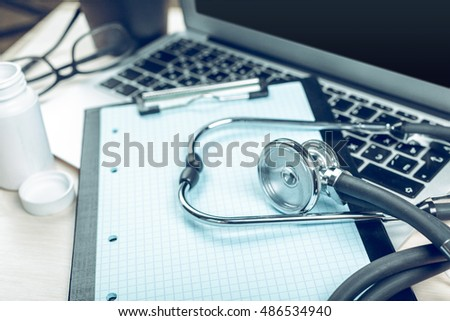 Stethoscope on laptop, close-up