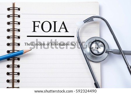 Stethoscope on notebook and pencil with FOIA (The Freedom of Information Act) words as medical concept.