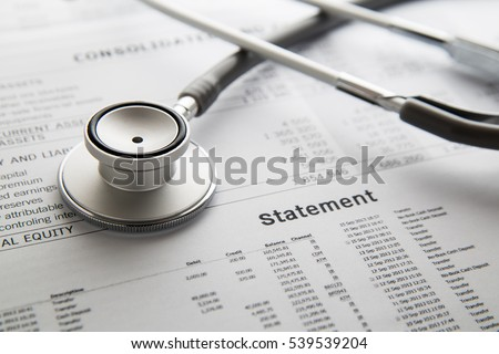 Stethoscope on the document. Financial concept