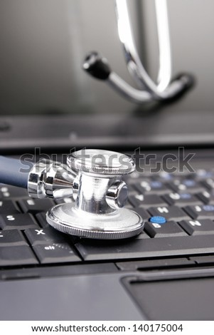 Stethoscope on the keyboard of laptop