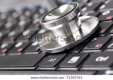 stethoscope on the laptop keyboard close up