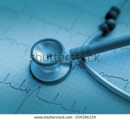 stethoscope on the printed ECG. monochrome photos - stock photo