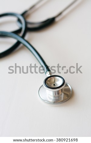 Stethoscope on white wooden background