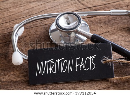 Stethoscope on wood with Nutrition Facts words as medical concept - stock photo