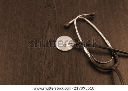 Stethoscope on wooden table with room for text