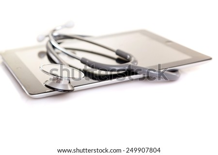 Stethoscope over a tablet computer, isolated over white background - stock photo