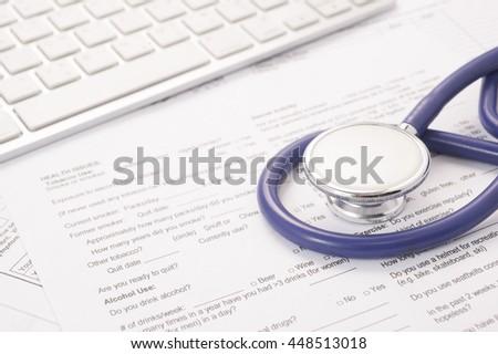 stethoscope put on medical Form - stock photo