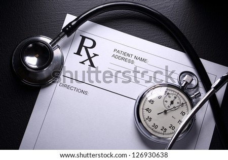 Stethoscope, stopwatch and patient list on black - stock photo