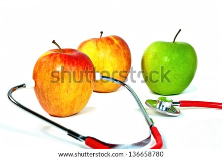 stethoscope with apples on white