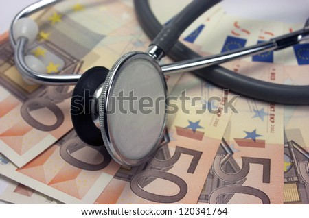 Stethoscope with fifty euro banknotes - stock photo