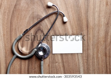 Stethoscope with health care concept on wooden background