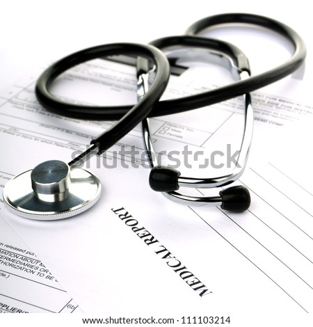 Stethoscope with health insurance on a white background - stock photo