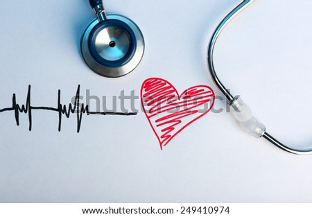Stethoscope with heart close-up - stock photo