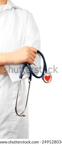 Stethoscope with heart in doctor hands, isolated on white - stock photo
