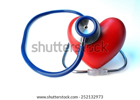 Stethoscope with heart on light blue background